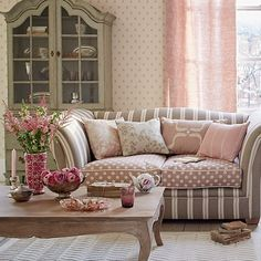 Blossom pink with taupe gives this modern, country living room a grown-up edge. Add character with a statement sofa that bravely mixes the colour palette and complete the look with wooden furniture in pastel painted or washed finishes.