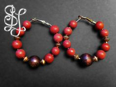 Sahara Desert Wood Hoop Earrings (from the Afro Carib Tribal Collection) feature red and chocolate brown wooden beads with accents of gold metallic beads. $30 on #Etsy by Sasha L Jewels LLC