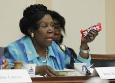 U.S. Rep Sheila Jackson Lee shows a bag of Skittles during her remarks at a public forum on the death of Florida teen Trayvon Martin, on Capitol Hill in Washington