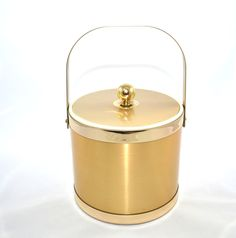Ice Bucket Gold Ice Bucket Faux Brushed Metal Ice Bucket Vintage Gold Ice Bucket Barware Bar Cart Georges Briard Ice Bucket by JudysJunktion on Etsy https://www.etsy.com/listing/223394834/ice-bucket-gold-ice-bucket-faux-brushed