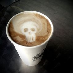 I like the idea that, if I had a café, the stencil used to dust cocoa powder and the formation of the froth could vary depending on the day and occasion. This could be for Halloween or Día de Los Muertos. Coffee Love, Coffee Art, Coffee Break, Coffee Shop, Drink Coffee, Morning Coffee, Barista, Latte Art, Skull And Bones