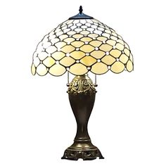 Make your decor more elegant with this Tiffany-style table lamp. This gorgeous lamp has a hand-designed glass shade and a gorgeous zinc base with an antique dark brown finish. It requires just one 60-watt bulb and has a simple-to-use pull-chain switch.