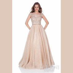 Terani Couture Prom Gown Cap sleeve prom gown with illusion neck and back. This prom dress is beaded on the waist and finished with a tulle ball skirt. Terani Couture Dresses Prom