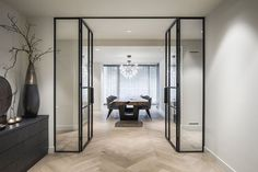 An opening with glass doors to the dining room. Designed by Kabaz. Home Interior Design, Interior Architecture, Interior And Exterior, Internal Doors, Home Living Room, Interior Inspiration, New Homes, House Design, Home Decor