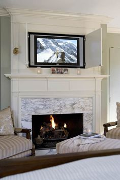 Explore images of stylish traditional fireplace mantels for inspirational design ideas on your own living room project from top designers FREE! Bedroom Fireplace, Tv In Bedroom, Home Fireplace, Fireplace Remodel, Fireplace Design, Fireplace Mantels, Fireplace Doors, Bedroom Doors, Mantles