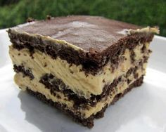 1 box chocolate graham crackers,  2 (3 1/4-oz) boxes vanilla instant pudding, 1C PB, 3 1/2C milk, 8 oz thawed Cool Whip, 1 can choco frosting-Spray 9x13 pan w/cooking spray. Line bottom of pan w/whole crackers. Mix pudding w/milk & PB 2 minutes. Fold in Cool Whip. Pour 1/2 pudding mix over crackers. Layer crackers on top of pudding layer. Pour remaining pudding mix over crackers & cover w/another layer of crackers. Heat frosting uncovered in microwave 1 minute. Pour over top of cake. Frig 12…