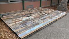 Rustic pallet deck made from 40 old pallets.
