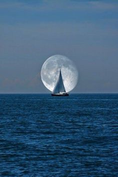 Full sail under a full moon, peace and tranquility
