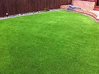 Artificial Grass - Originally limited to large sports clubs, the market for artificial grass has dramatically increased over the last few years, meaning you are just as likely to see it in your neighbours' garden as you are on a football pitch.  With various styles, shades, and pile heights you are able to emulate your picture perfect green lawn with no effort at all.  Gardens 2 Glow work in partnership with Tiger Turf's recommended installers who complete our grass projects.