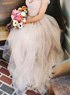 Gorgeous blush wedding gown with a beautiful bouquet