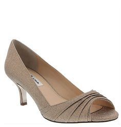 The Carolyn pump is an elegant and sophisticated choice done in a beautiful golden taupe shimmery fabric. The low heel height, color, and comfort make her the perfect low pump for dancing all night or comfortably staying on your feet for any festive occasion from a wedding to a holiday party! The Carolyn in golden taupe shimmer is one of our mother of the bride favorites for 2016! | Nina Shoes | Carolyn…