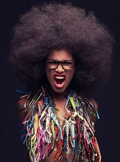 Love the hair, expression, necklace. I am woman; hear me roar!!!!
