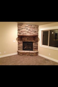 stone Fireplace and stone hearth with angled corners More