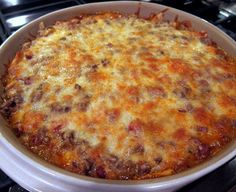 Easy Mexican Casserole INGREDIENTS: 1 pound lean ground beef 1 can Ranch Style beans 1 10-12 ounce bag tortilla chips, crushed 1 can Ro-tel tomatoes 1 small onion, chopped 2 cups shredded cheddar cheese, divided 1 package taco seasoning 1 can cream of chicken soup 1/2 cup water sour cream and salsa for serving