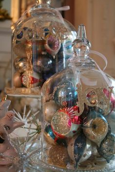 Vintage ornaments under a cloche, very festive!