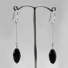 Simple faceted black onyx drop earrings handmade in our London workshops. These lovelies are super chic and sophisticated.