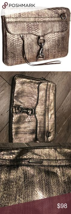 """Rebecca Minkoff Laptop Bag This snake-embossed leather laptop sleeve features a zip pocket and spring lock at the front and a logo plate at the back. Long pull at zip closure no longer attached. Padded, lined faux velvet interior. This item is in great used condition. The signs on wear are minimal if any. Please see photos. 13.5""""L x 1""""H x 10""""W Rebecca Minkoff Bags Laptop Bags"""