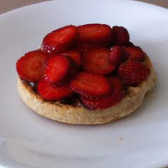 Whole wheat waffle, nuttella, fresh sliced strawberries and a drizzle of honey mmmm and healthy!