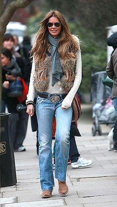 Cream top, brown fur vest, denim boot cut jeans, camel western boots, dk brown western belt, teal oblong scarf - Elle MacPherson