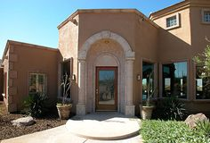 Cantera arch to accent a beige home.