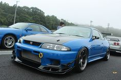 Rare Competition Blue GT-R with Auto Select hood, front lip/canards, GT Wing, GANADOR mirrors, with Volk at all fours. Nissan Skyline Gtr R33, R33 Gtr, Nissan 370z, Nissan Silvia, Tuner Cars, Lamborghini Gallardo, Car Manufacturers, Dream Cars, Auto Racing