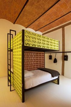 Splashy bunk beds made from yellow lattice brick outfit this stylish hostel in central Mexico City designed by architect Abraham Cherem. Photo by Undine Pröhl. This originally appeared in A Stylish Budget Hostel in Mexico City. Hostels, Hemnes, Dormitory, Suites, Prefab Homes, How To Make Bed, Interiores Design, Mexico City, Bunk Beds