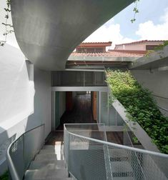 House N° 11- entrance to the original house. Sitting comfortably side by side, the old part of the house and new part of the house visually regard each other across an open central courtyard. The two structures are knit together by a central staircase comprising of thin steel bridges stretching from one level to the next, criss-crossing the courtyard space. As such, occupants pass through the old and new parts of the house in alternate fashion as one traverses this staircase.