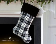 A handsome mens plaid Christmas stocking with timelessly classic appeal, its a gift in itself! This traditionally styled piece features striking black and off white tartan plaid made of 100% wool. Stocking is fully lined with sturdy black 100% cotton, capable of holding lots of goodies at Christmastime. Black 100% cotton twill reverse. Topped with an extra thick black cotton velvet cuff. This exceptionally crafted stocking boasts a heft as substantial as its style.  ~ 100% fine wool tartan…