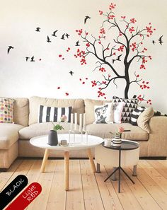 Creative living room decor with leaves and cute birds. This tree decal is also great as nursery decor.