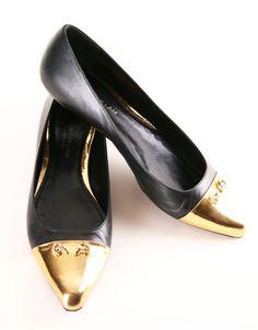Gold Cap-Toe Flats.