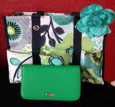 Jewell- all about the Benjamins wallet paired with the Thirty-One zip top organizer tote & a floral clip!