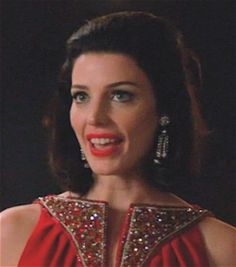 Season 5, Christmas Waltz episode, Megan wears these rhinestone earrings that drip with rhinestone chain links.  Could be the work of Weiss, Juliana D, Hobe, Vendome or maybe Hattie Carnegie.