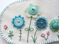 felt, embroidery, and buttons - such cute flowers
