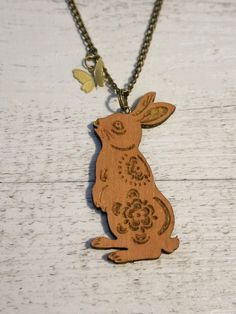 handmade wooden necklace Hare and butterfly  by scodinzolo on Etsy