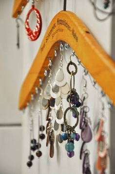 DIY: Take a sturdy wooden hanger and add hooks to hang earrings, necklaces, etc.