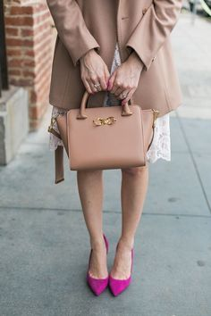 camel coat with bow