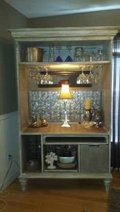 repurposed TV armoire now a bar. This is going to be one of my projects and i will write about it on my blog. www.newlifedecorandmore.com