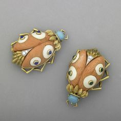 coral ladybug brooches 1950