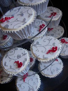 silver lace wedding cupcakes.  *I need to try this by laying a piece of lace on the top of the cupcake and dust with colored sugar*