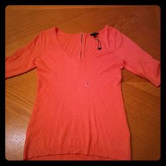 Sweater Never worn Express sweater. Tag still attached. 3-quarter sleeves, light orange sweater with a zipper in the back Express Sweaters V-Necks