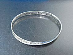 Sterling Silver Serenity Bangle Bracelet Serenity Courage Wisdom inner diameter 2 5/8 inches 1/4 inch wide twist on one side.