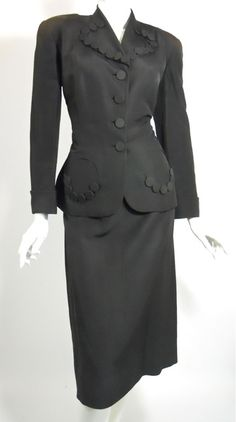 1940s Rayon Suit. Check out the button trim on the collar and pockets. They were so innovative and creative with suits back then.