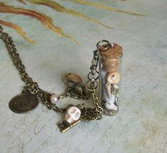 Sea treasure glass vial necklace by talulahblue on Etsy, £25.00