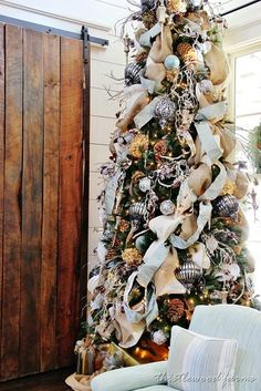 Outdoor Christmas Tree, Pinecones, Blue and Silver Ornaments, Dried Hydrangea Heads, Blue and Burlap Garland, Southern Living Idea House