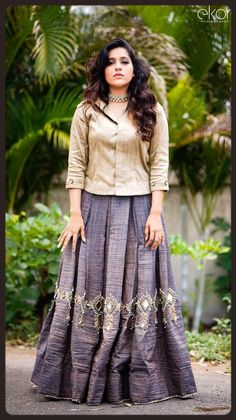 Rashmi Gautam looks stunning in gray color skirt and gold hade top. Skirt with hand embroidery silver thread work. She adorned with statement necklace. She leave her wavy hair to round her look for Jabardasth. Long Gown Dress, Frock Dress, Long Dresses, Crop Top Designs, Blouse Designs, Haircuts For Wavy Hair, Neck Designs For Suits, Long Dress Design, Skirt Fashion