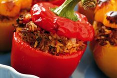 Slow Cooker Southwestern Stuffed Peppers are loaded with healthy ingredients like corn, black beans, ground turkey, and brown rice.  #slowcooker #stuffedpeppers #healthyrecipes