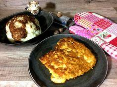 Hähnchenschnitzel in einer Ei-Panade und Blumenkohl - lowcarb Abendessen. Mit Hähnchenbrustfilet, Ei und entöltem Mandelmehl. Rezept mit Nährwerten