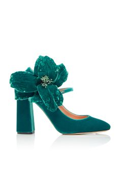 This **Rochas** pump is rendered in velvet and features a floral embellishment and block heel.