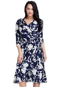 What's New // Pretty is an understatement when it comes to this plus size blue floral ruffled wrap dress.