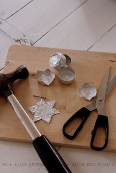 Recycle tealight tins into Christmas ornaments. Poke hold in one point and string with ribbon to hang. super simple!